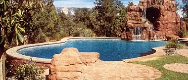 Aqua Dream Swimming Pool Gallery waterfall from cave into freeform pool