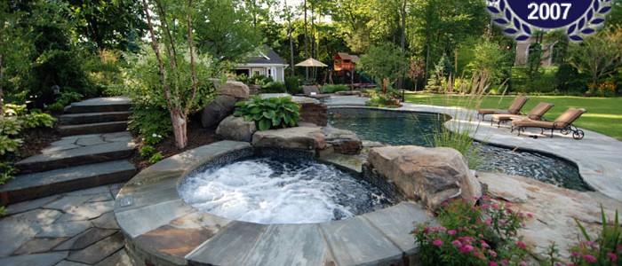 Aqua Dream Swimming Pool Gallery stone hot tub