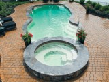 Aqua Dream swimming pool gallery side view of freeform pool with hot tub