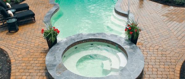 Aqua Dream Swimming Pool Gallery freeform lap pool with hot tub