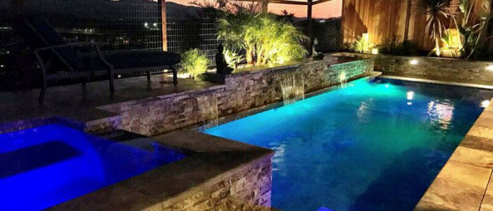 Geometric pool at night built by Aqua dream Pools in California